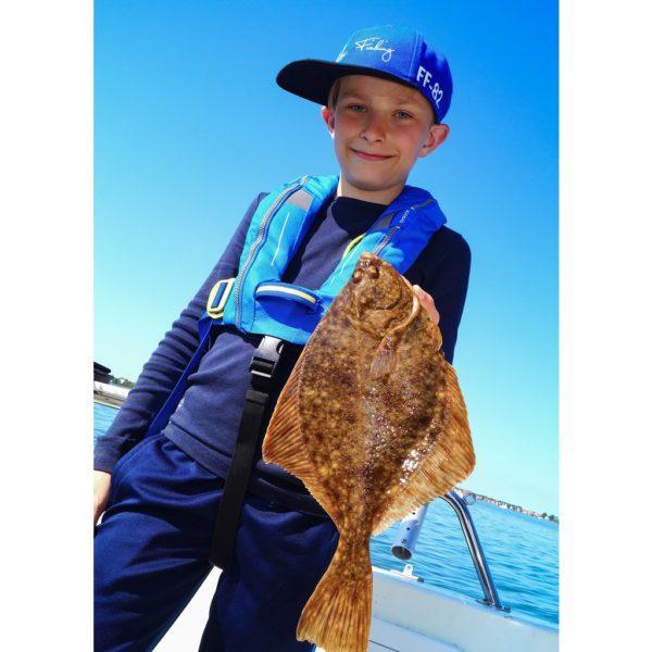 blong boy holding fish in Spinlock Deckvest Cento Junior Lifejacket